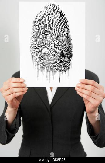 Businesswoman holding a fingerprint photo - Stock-Bilder