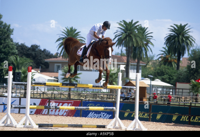jumping rider Lopez Lizaro on Ohio of the Padenborre, jumping over show jump. - Stock Image