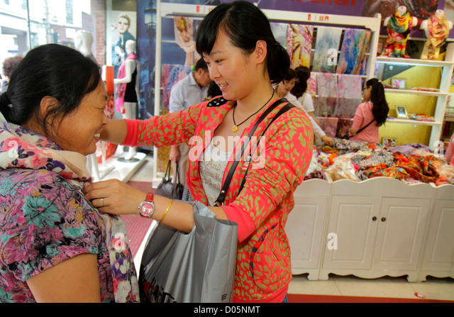 Shanghai China Huangpu District East Nanjing Road National Day Golden Week shopping for sale Asian woman scarves - Stock Image