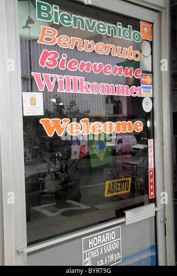 Panama City Panama Bella Vista storefront window painted glass sign multilingual welcome bienvenido Benvenuto Bienvenue - Stock Image