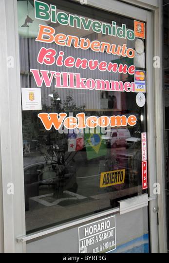 Panama Panama City Bella Vista storefront window painted glass sign multilingual welcome bienvenido Benvenuto Bienvenue - Stock Image