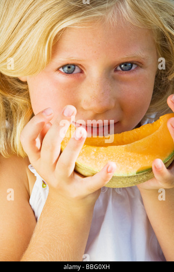 Girl with a slice of melon - Stock Image
