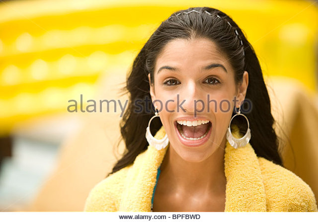 Surprised mixed race woman with mouth open - Stock Image