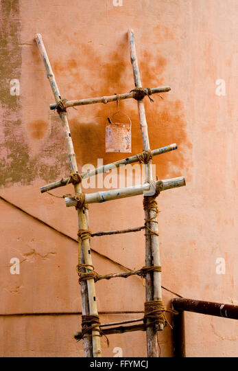 Tin hanging on bamboo stair - Stock Image