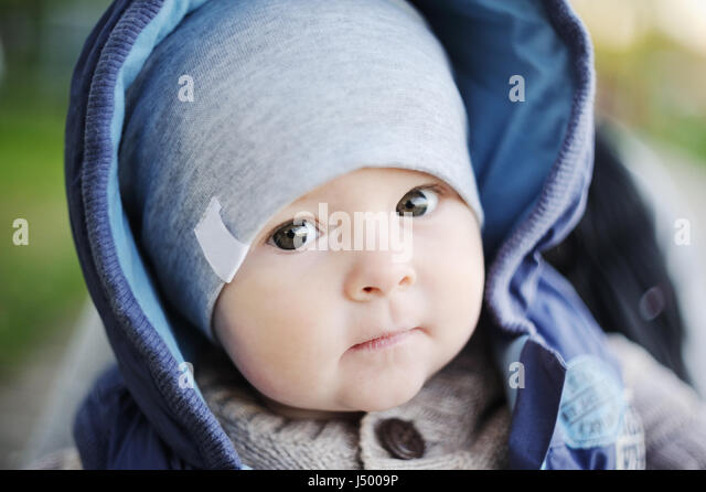 portrait of a cute kid in the hood - Stock Image