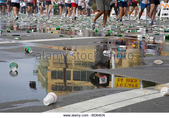 Scattered Paper Cup on Pavement at a Marathon - Stock Image