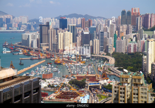China Hong Kong Island Wan Chai high rise skyscraper buildings city skyline Victoria Harbour Kowloon Bay Causeway - Stock Image