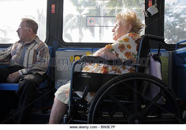 Miami Florida Metrobus mass transit public transportation passenger wheelchair ADA accessible woman man senior disabled - Stock Image