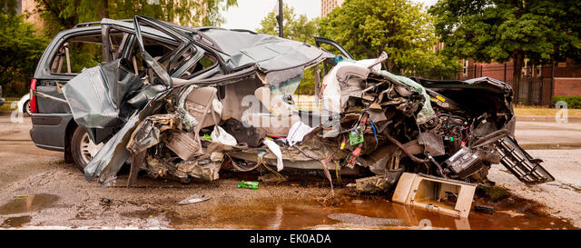 Totaled minivan; car after terrible collision. - Stock Image