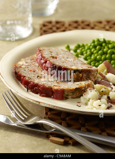 Turkey meatloaf dinner with potato and peas - Stock Image