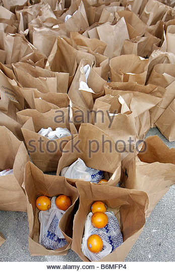 Miami Florida Alpha-Omega Church Thanksgiving turkey give-away give away free food needy volunteers Hispanic brown - Stock Image