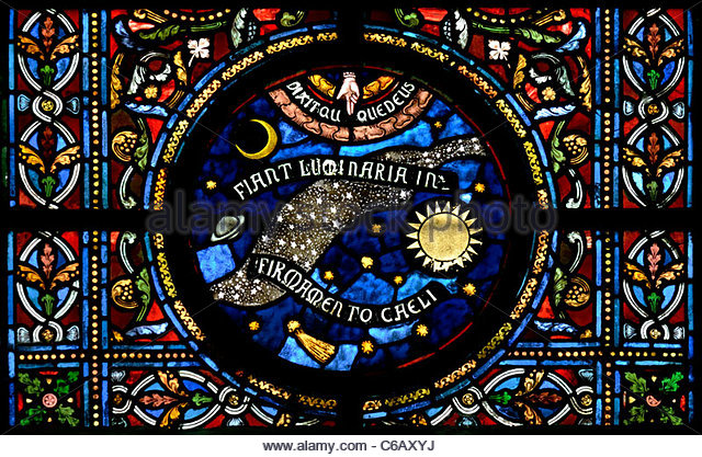 Dinant, Belgium. Eglise Notre-Dame. Stained glass window. Latin - 'Let there be light in the firmament of heaven' - Stock Image