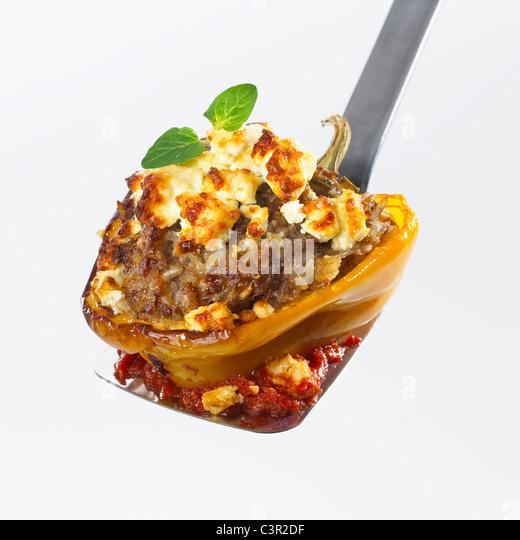 Stuffed bell pepper on spatula, close-up - Stock-Bilder