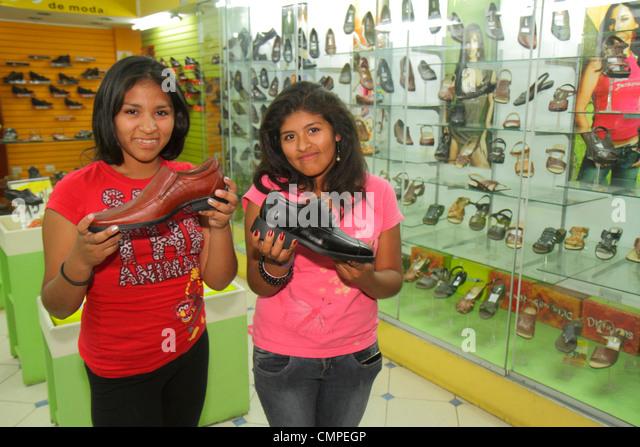 Peru Tacna Avenida San Martin commercial district retail shoe store footwear business shopping display men's - Stock Image