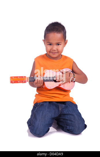 A portrait of a cute asian boy with guitar - Stock Image