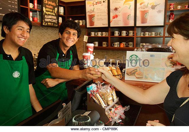Peru Lima Barranco District Avenida Pedro D'Osma Starbucks Coffee coffee house business American company brand - Stock Image
