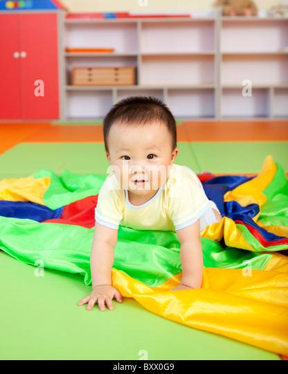 Baby Boy Crawling - Stock Image
