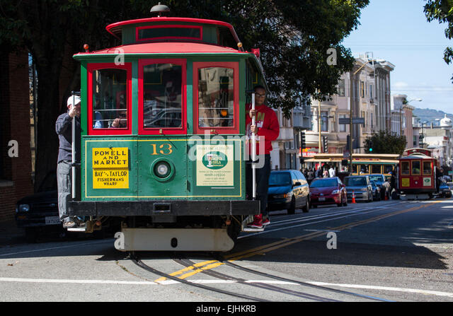 Riding the cable car on the hills of San Francisco, California, USA - Stock Image