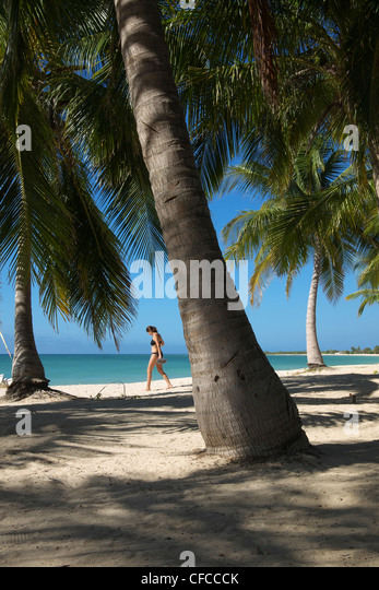 Allison Webb heads down to the water for a swim at Playa Ancon near Trinidad Cuba - Stock Image