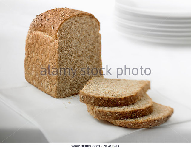 Close up of sliced loaf of fresh bread - Stock Image
