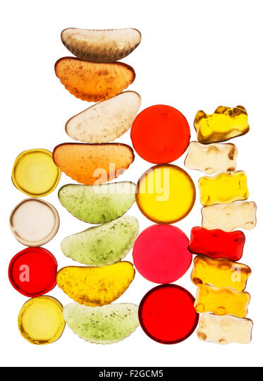 brightly colored translucent candy stacked into four vertical towers - Stock Image