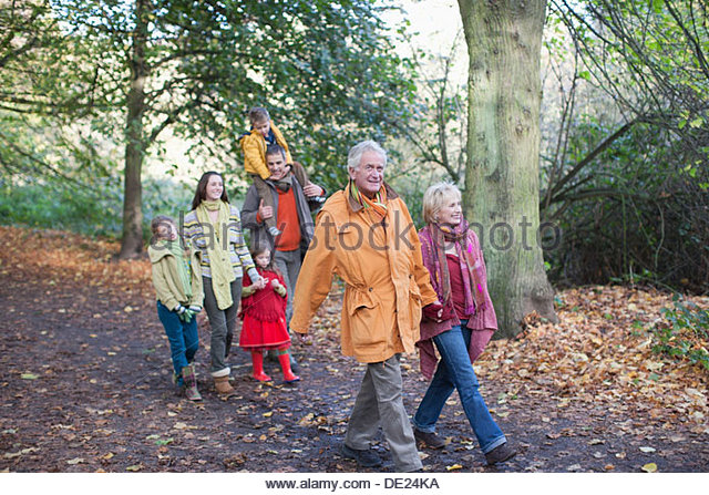 Extended family walking outdoors in autumn - Stock-Bilder