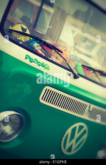 Peace sticker on the front of a VW Campervan with added nostalgic filter - Stock Image