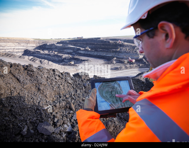 Ecologist examining surface coal mine - Stock Image