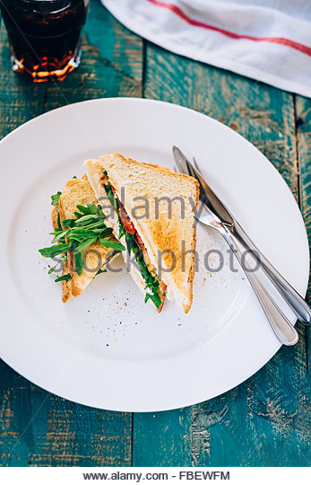 Vegetable sandwich sits on a plate - Stock Image