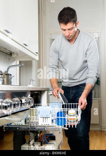 Man with dishwasher - Stock-Bilder