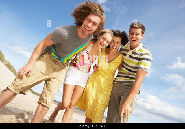 Group Of Friends Having Fun On Summer Beach - Stock Image