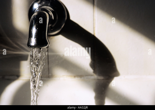 Running Water from Faucet in Bathroom - Stock Image
