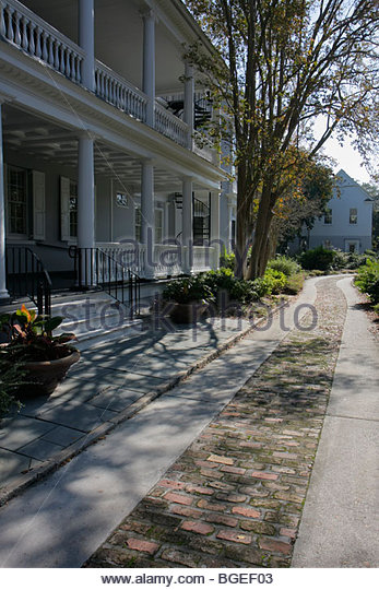 South Carolina Charleston National Historic Landmark Historic District Broad Street driveway pavers house mansion - Stock Image