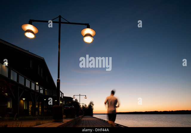 Man jogging on waterfront, Lulea, Sweden - Stock Image