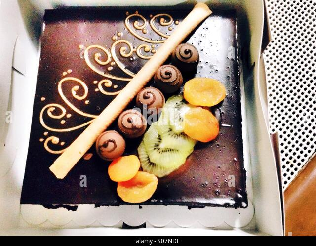 Beaiutiful cake given to me by my family when I celebrated my birthday. Filled with my favorite goodies and fruits, - Stock Image