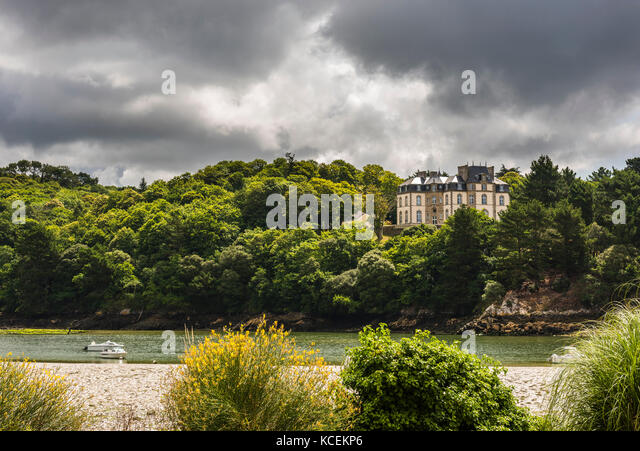 Storm clouds over the river at Audierne, Brittany, France - Stock Image