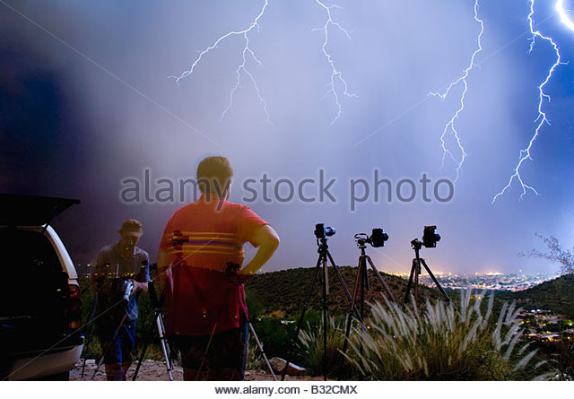 Famous storm chasers Jeff Smith on left and A. T. Willett out shooting lightning near Sabino Canyon when a huge - Stock Image