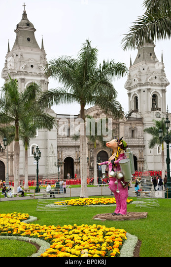 Peru. Plaza Mayor with Lima Cathedral. Attractive modern statues decorate the gardens. - Stock Image