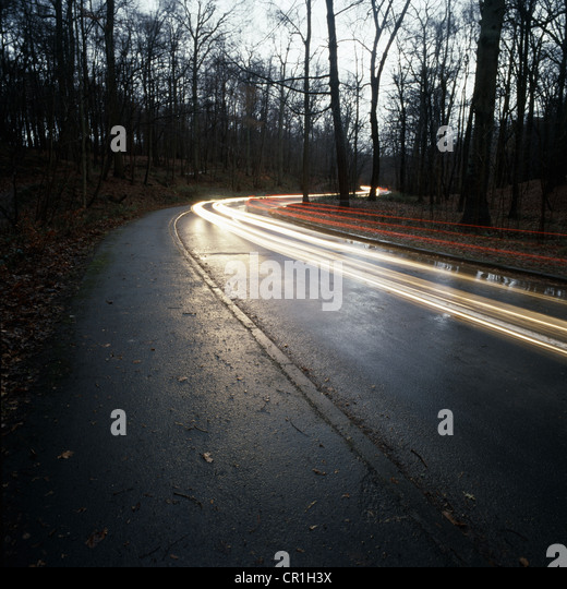 Time lapse view of traffic on rural road - Stock Image