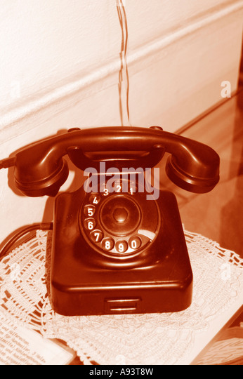 old telephone with rotary dial - Stock Image