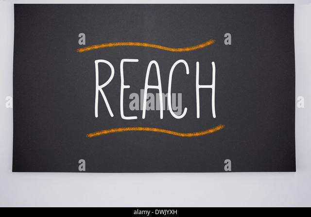 Reach written on big blackboard - Stock Image