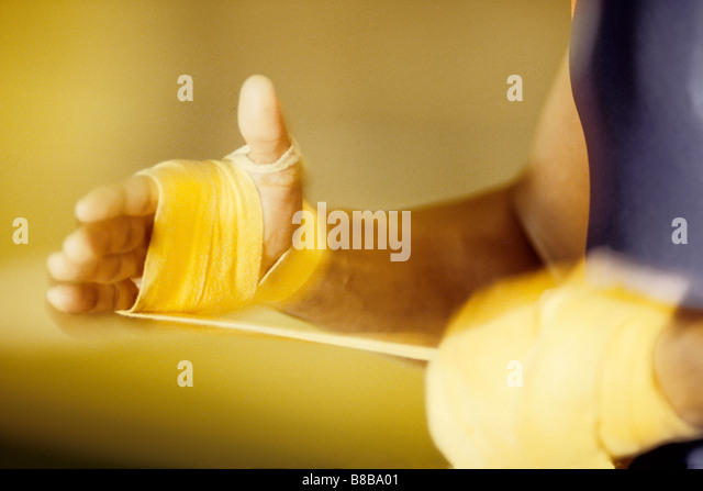 Detail of boxer wrapping his hands - Stock Image