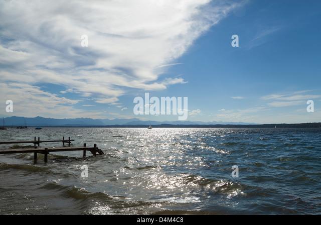 Wooden piers over ocean - Stock Image