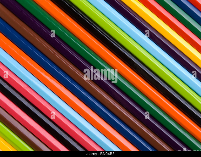 Top view of assorted color pencils disposed one next to the other. - Stock Image