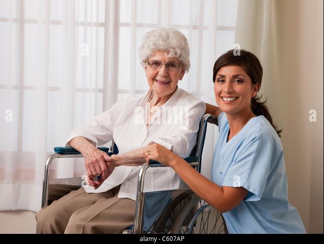 USA, Illinois, Metamora, Portrait of female nurse and senior woman on wheelchair - Stock Image