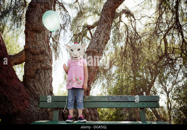Child in costume of sheep head mask - Stock-Bilder