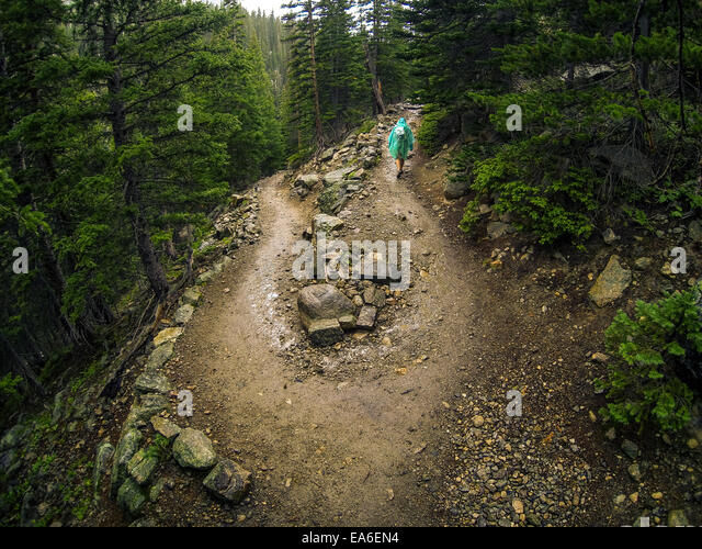 USA, Colorado, Larimer County, Hiker conquering adversity during rainy hike in Rocky Mountain National Park - Stock Image