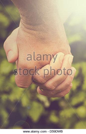 couple holding hands - Stock-Bilder