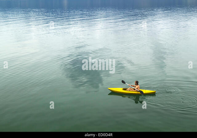 Man kayaking on Lake Toba, Sumatra, Indonesia - Stock Image