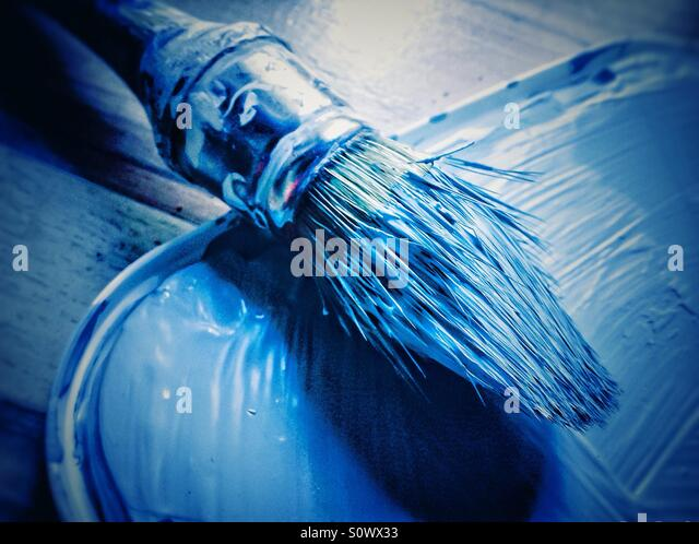 Paint brush of blue paint - Stock Image